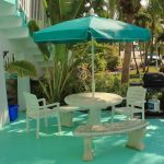 Table outside unit 12 with umbrella and grill Gulf View Waterfront Resort Marathon Florida